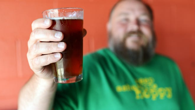 Asheville Brewing is releasing a new beer to benefit the United Way of Asheville and Buncombe County. Pictured is brewer Doug Riley.
