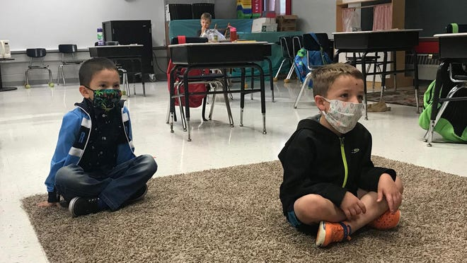 A couple of young Independence School District students observe a lesson during summer school at Mill Creek Elementary in July. The district still plans to start its fall semester Aug. 24, citing its success with summer classes and activities.