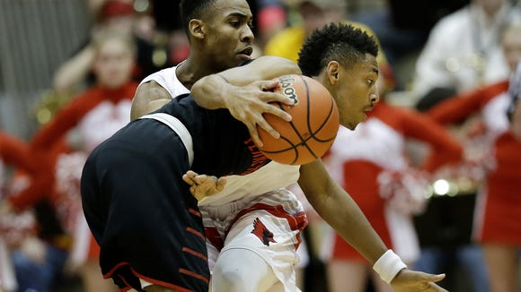 Southport guard Paul Scruggs (1) defends against Terre Haute South Vigo guard Jaylen Minnett at Southport High School in Indianapolis on March 12, 2016.