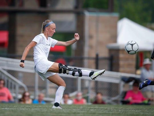 Ankeny Centennial senior Megan Gray kicks the ball