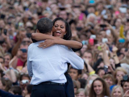 First lady Michelle Obama hugs President Barack Obama