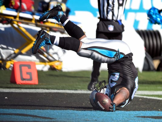 Carolina Panthers' Jonathan Stewart (28) falls into the end zone for a touchdown against the Minnesota Vikings during the first half of an NFL football game in Charlotte, N.C., Sunday, Dec. 10, 2017. (AP Photo/Mike McCarn)