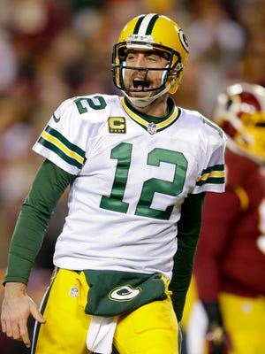 Green Bay Packers quarterback Aaron Rodgers reacts after throwing a second quarter touchdown pass to Randall Cobb.