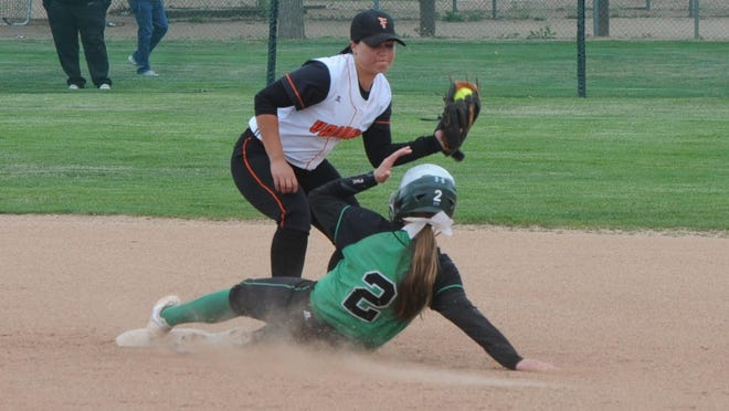 Fernley shortstop tries to tag Fallon's Caitlin Welch during a game at the Division 1-A state softball tournament last Friday at Shadow Mountain Park in Sparks.