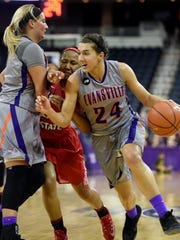 Kerri Gasper of Evansville sets a pick on Viria Livingston of Illinois State for Sara Dickey, right, during the first quarter of the game against Illinois State at the Ford Center in Evansville Sunday.  Evansville got their third straight win with a 60-56 win Sunday.