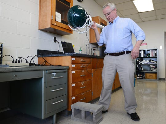MSU chemistry professor Gary Blanchard demonstrates how they test impact at a lab in the Chemistry Building at Michigan State University on Thursday, March 10, 2016. Blanchard, along with fellow professor Marcos Dantus, created a product, which fits in an athletic headband, to test high impact collisions. While the device does not show whether an athlete has a concussion, it can help trainers know when a player needs further examination.