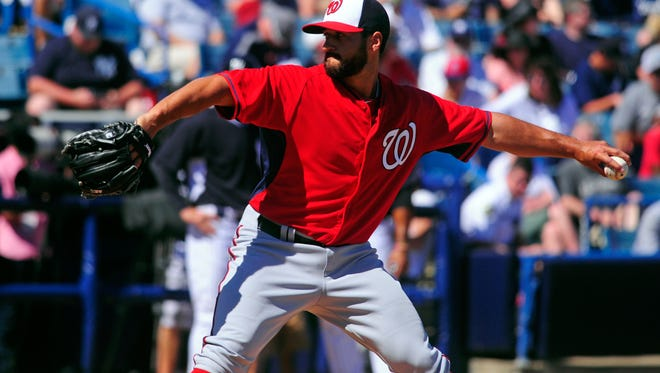 Danny Rosenbaum pitches for the Nationals at spring training in March of 2014.