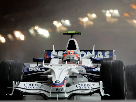 FILE - In this Sunday, May 25, 2008 file photo, BMW Sauber Formula One driver Robert Kubica of Poland drives his car to finish second at the Monaco Formula One Grand Prix in Monaco. After nearly losing his right hand, Robert Kubica could be gripping a Formula One steering wheel with it next year.  (AP Photo/Frank Augstein, File)