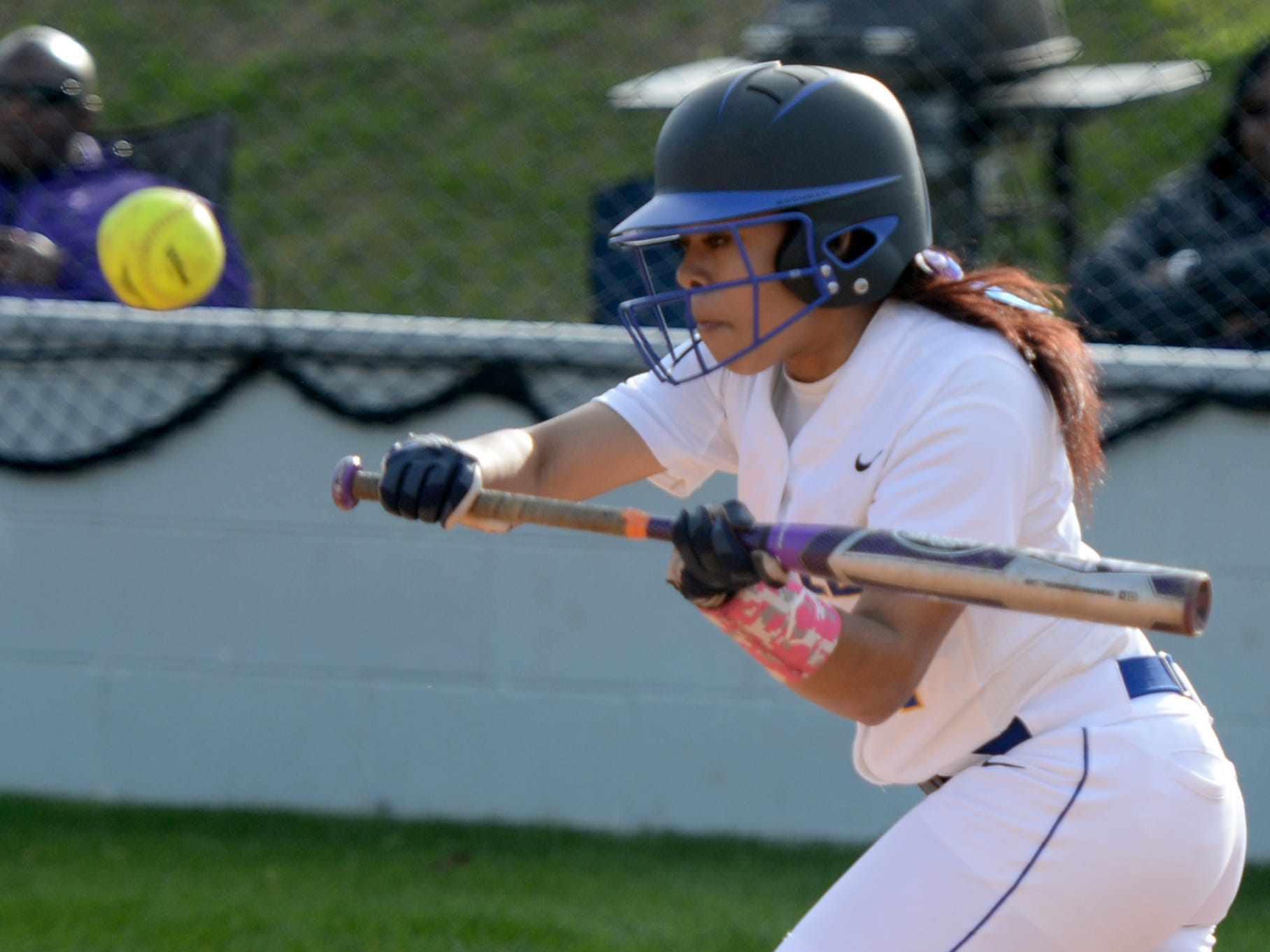Jackson Christian's Kacie Lynch goes for a bunt during Monday's game against Madison.