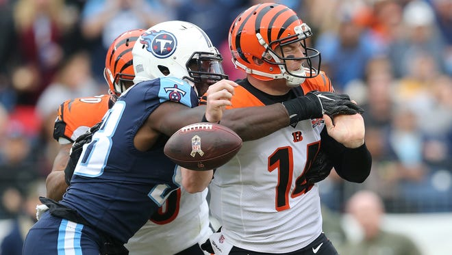Tennessee Titans outside linebacker Brian Orakpo (98) forces a fumble of Cincinnati Bengals quarterback Andy Dalton (14) in the second quarter during the Week 10 NFL game between the Cincinnati Bengals and the Tennessee Titans, Sunday, Nov. 12, 2017, at Nissan Stadium in Nashville, Tennessee.