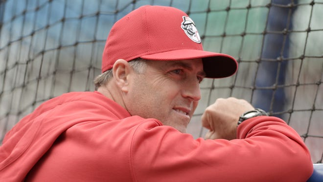 Cincinnati Reds manager Bryan Price (38) watches batting practice before the game against the Kansas City Royals at Kauffman Stadium.
