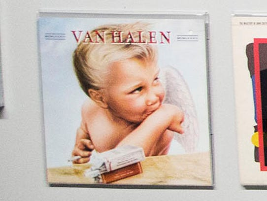 "Van Halen's ""1984"" album cover designed by Margo Nahas hangs among many covers, designed by herself and her husband Jay Vigon."