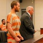 Matthew Roberts appears in court with defense attorney Scott Erdbacher.