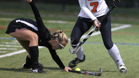 Mamaroneck's Lizzie Clarke, right, is pressured by