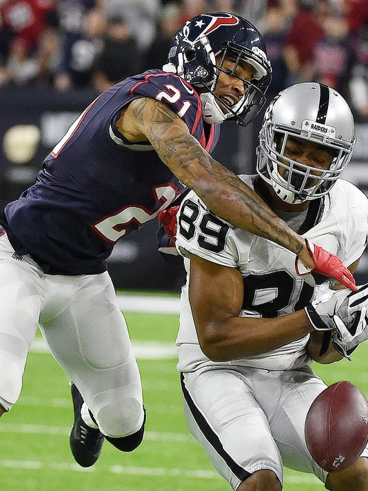 Oakland Raiders wide receiver Amari Cooper (89) drops a pass against Houston Texans' A.J. Bouye (21) during the second half of an AFC Wild Card NFL game Saturday, Jan. 7, 2017, in Houston. (AP Photo/Eric Christian Smith)