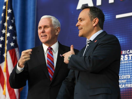 Vice-President Mike Pence is greeted on the stage by