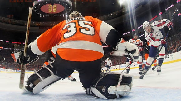 Steve Mason was hurt in Sunday's win over the Washington Capitals.