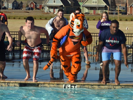 A handful of brave young men joined the Clemson University Tiger mascot Sunday for a  plunge.