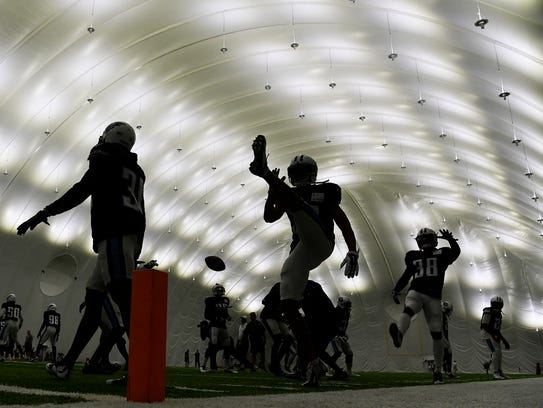 Bad weather forced the Titans to practice in their