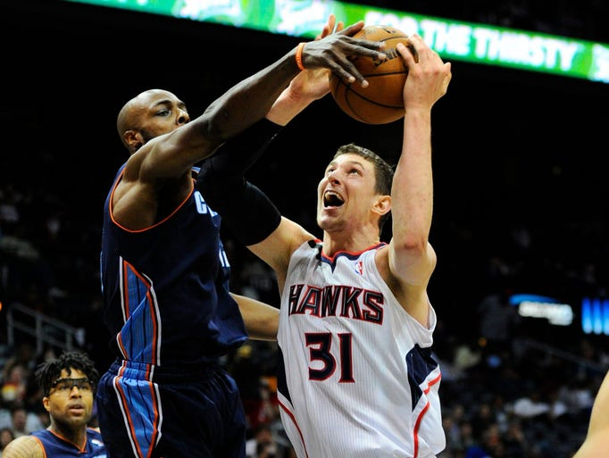 Charlotte Bobcats forward Anthony Tolliver (43) blocks the shot of Atlanta Hawks center Mike Muscala (31) during the second half at Philips Arena on April 14, 2014. The Bobcats defeated the Hawks 95-93.