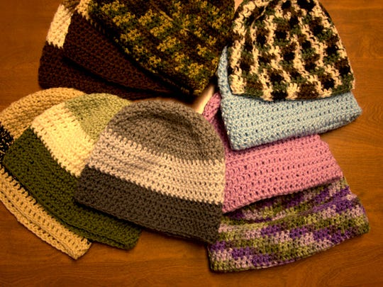 A sample of the hats that Anna Lauer crochets every year. Between the fall of 2015 and January 2016, she has already crocheted over 200 hats for children and families.