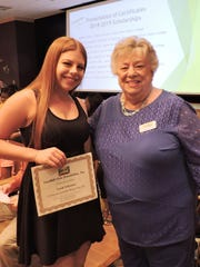 Scholarship recipient Sarah Poltroneiri and Sandhill Cove Foundation committee member Ellyn Capper.