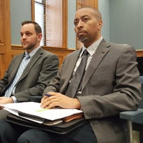 Kevin Richard (left), deputy secretary of the Louisiana Department of Revenue, and Luke Morris, Revenue Tax Assistant Director Luke Morris, listen to testimony at the Task Force on Structural Changes in the Budget and Tax Policy Friday.