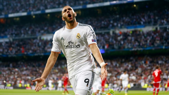 Real Madrid's Karim Benzema celebrates scoring the opening goal against Bayern Munich during their first leg Champions League semifinal first match.