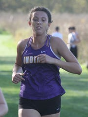 Indianola senior Grace Berg runs in the front pack.