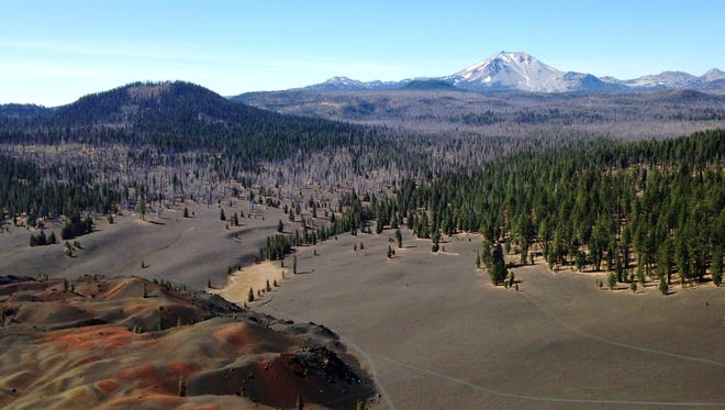 Views from the top of Cinder Cone take in the colorful Painted Dunes and Lassen Peak.