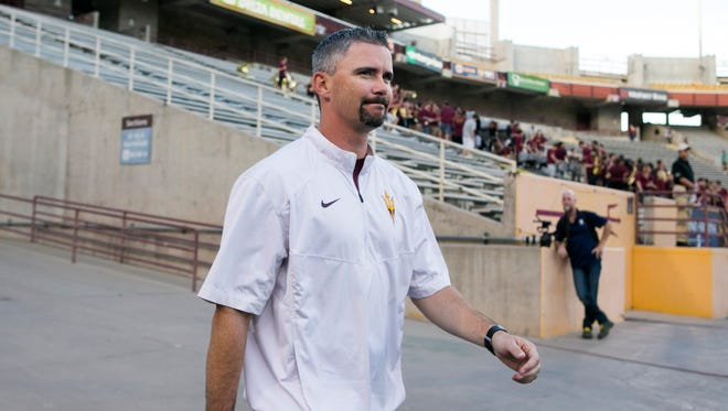 ASU deputy head football coach Mike Norvell takes the field before the ASU spring football game at Sun Devil Stadium on April 10, 2015.