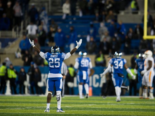 Kentucky safety Darius West (25) raises his hands near the end of the Tennessee vs. Kentucky game at Kroger Field in Lexington, Kentucky Saturday, Oct. 28, 2017. Kentucky defeated Tennessee 29-26.