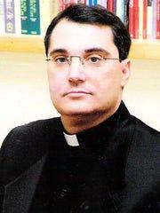 Father John Pasquni of St. John's of the Cross Catholic Church in Vero Beach.
