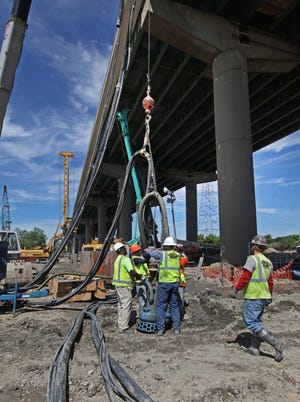 Repairs to the I-495 bridge that crosses over the Christina River continue, Friday, June 20, 2014.