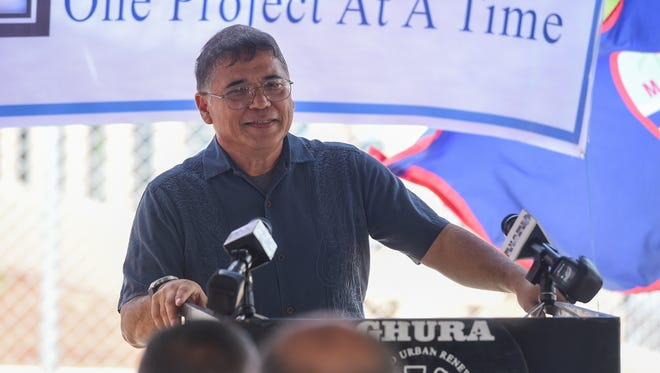 Guam Housing and Urban Renewal Authority Executive Director Michael J. Duenas speaks during the Astumbo 5 Homes Home Program Project ribbon cutting ceremony in Dededo on Dec. 5, 2017.