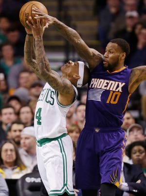 Boston Celtics guard Isaiah Thomas (4) shoots past the attempted block by Phoenix Suns guard Sonny Weems (10) during the second half of an NBA basketball game Friday, Jan. 15, 2016, in Boston. The Celtics defeated the Suns 117-103.