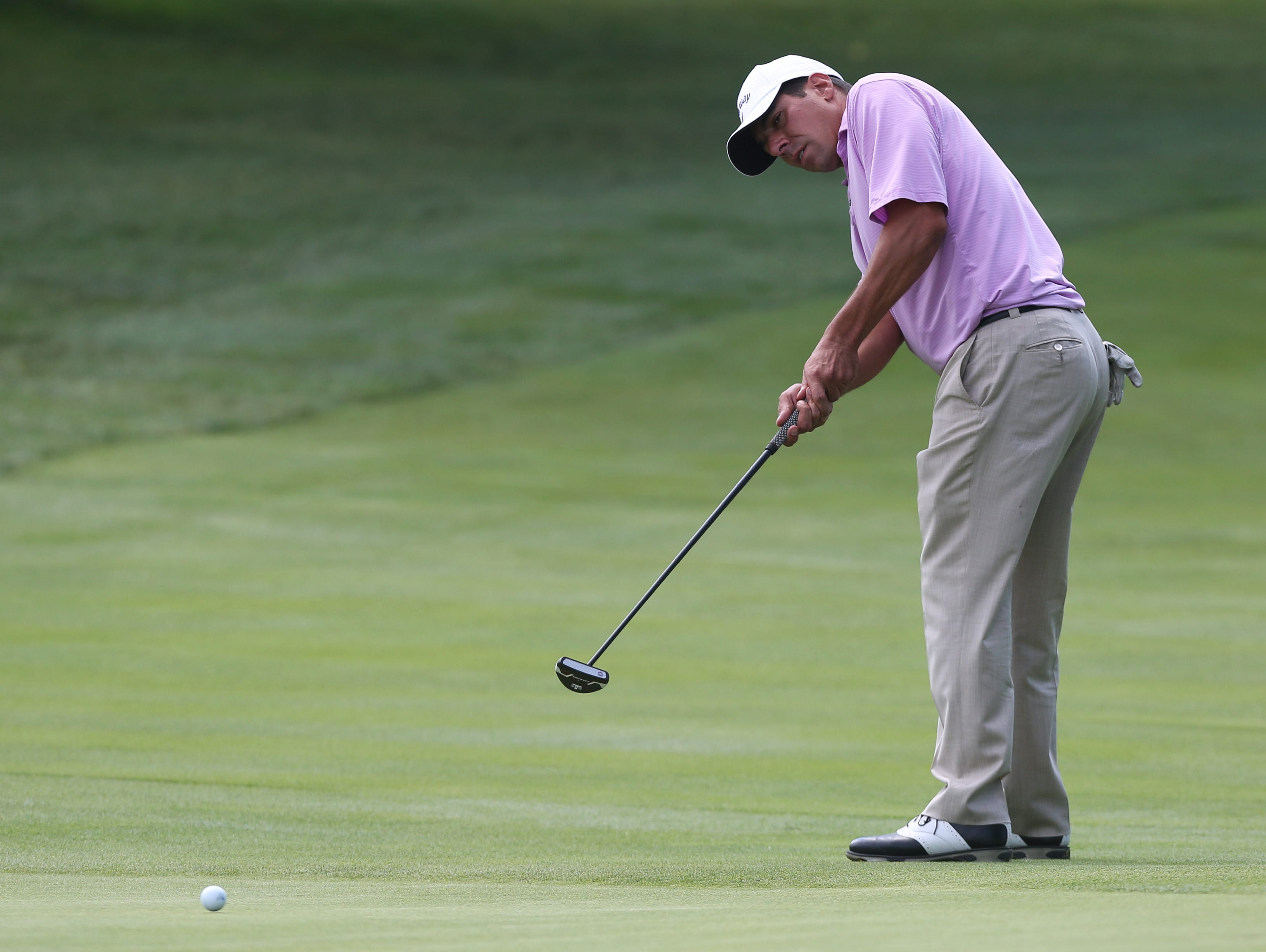 Charlie Meola, of Saxon Woods Golf Course, putts on the 18th green during the Metropolitan PGA Professional Championship at Fairview Country Club in Greenwich, CT. Aug. 5, 2015.