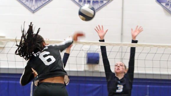 Ursuline's Katie McLoughlin goes up for a block on a kill by Ossining's Mychael Vernon during the Section 1 Class AA volleyball final at Hendrick Hudson High School in Montrose on Friday.
