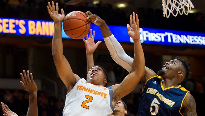 Chattanooga's Justin Tuoyo (5) blocks a shot attempted by Tennessee's Grant Williams (2) during the second half against Chattanooga at Thompson-Boling Arena on Friday, Nov. 11 2016. Chattanooga defeated Tennessee 82-69.