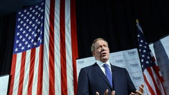 George Pataki speaks with the media prior to announcing