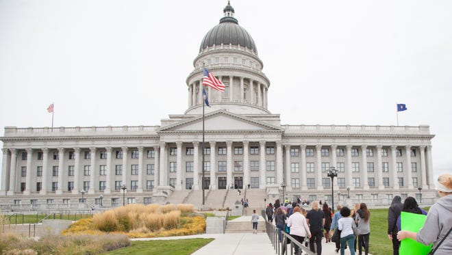 Dozens of Utah women march to the Capitol during the annual Slut Walk to bring awareness to sexual assault and rape culture Saturday, Sept. 30, 2017.