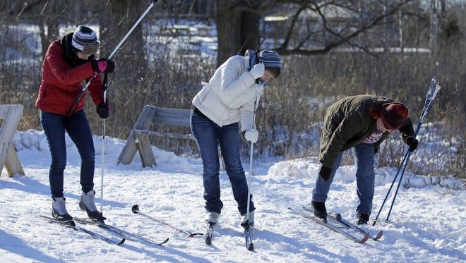 Diana (left), Laura, and Janet Breza of Berlin get ready to ski at Gordon Bubolz Nature Preserve in Appleton on Jan. 2.