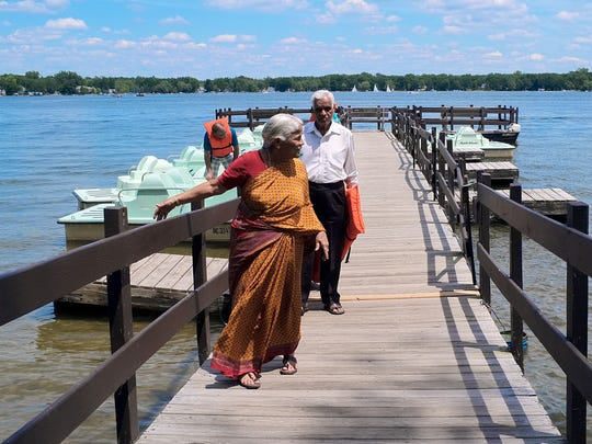 The Athri family, visiting from India, just finished riding a paddle boat at Lake Lansing on Sunday.