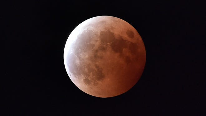 This file photo taken on October 8, 2014 shows a lunar eclipse as seen from Tokyo.