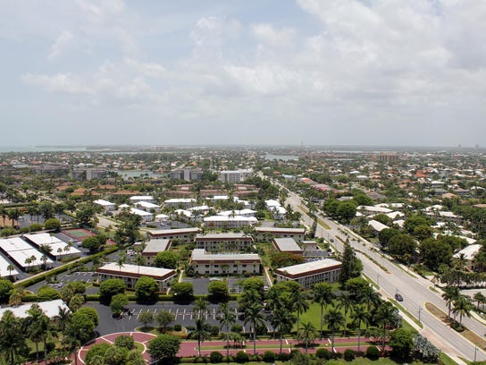 File, looking north down Collier Boulevard from a beachfront