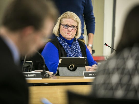 South Burlington City Council member Pat Nowak listens