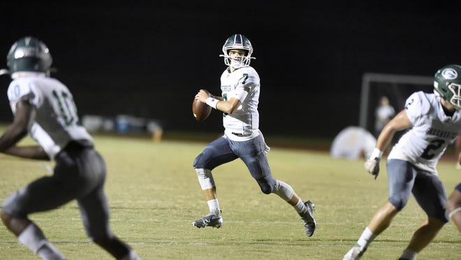 Greenbrier quarterback Brooks Pangle looks to pass during football action at Grovetown High School in Grovetown, Ga., Friday evening Sept. 25, 2020.