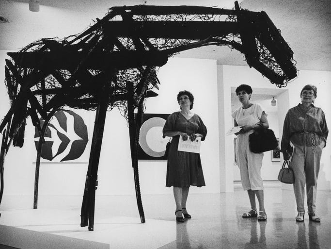 "Artists Jo Galloway, Loretta Komito and Shirley Lavine at view the sculpture ""Ponder"" by Deborah Buterfield at the Phoenix Art Museum in June 1981."