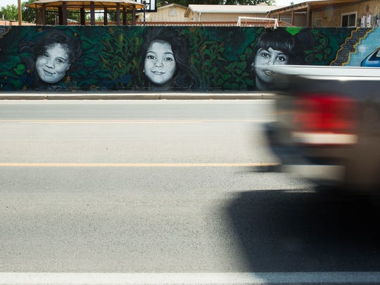 A mural depicting the Kardashian sisters when they were young painted on a wall along Locust Avenue, Tuesday, June 6,2017.