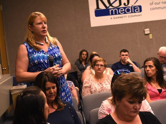 Parent Lisa Hickman, left, speaks during the Reno Gazette-Journal's